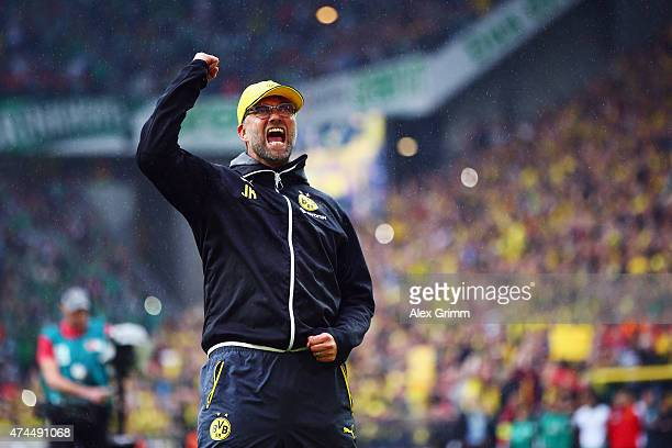 Head coach Juergen Klopp of Dortmund says farewell to the fans after the Bundesliga match between Borussia Dortmund and Werder Bremen at Signal Iduna...
