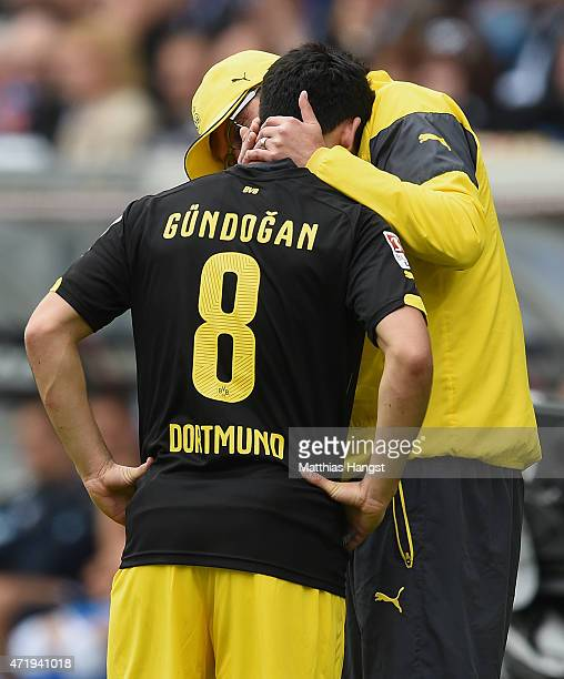 Head coach Juergen Klopp of Dortmund speaks to Ilkay Guendogan of Dortmund during the Bundesliga match between 1899 Hoffenheim and Borussia Dortmund...