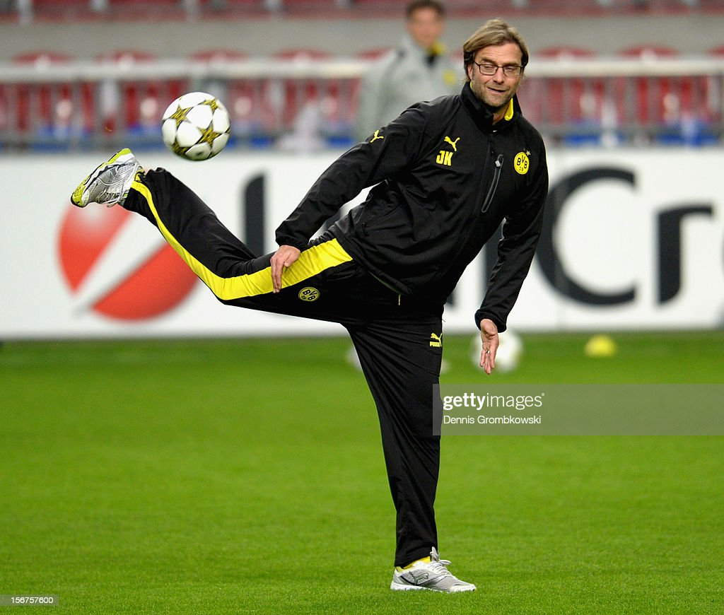 Head coach Juergen Klopp of Dortmund stops a ball during a training session ahead of the UEFA Champions League match against Ajax Amsterdam on November 20, 2012 in Amsterdam, Netherlands.