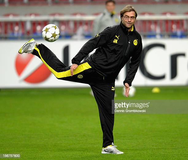 Head coach Juergen Klopp of Dortmund stops a ball during a training session ahead of the UEFA Champions League match against Ajax Amsterdam on...