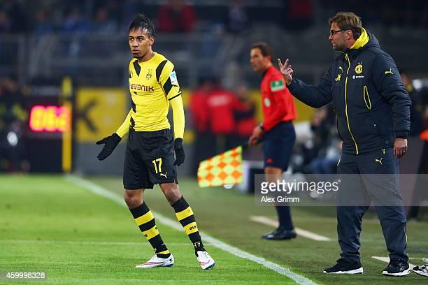 Head coach Juergen Klopp of Dortmund talks to PierreEmerick Aubameyang during the Bundesliga match between Borussia Dortmund and 1899 Hoffenheim at...