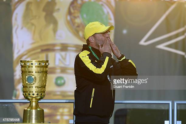 Head coach Juergen Klopp of Dortmund walks past the DFB Cup after loosing the DFB Cup Final match between Borussia Dortmund and VfL Wolfsburg at...