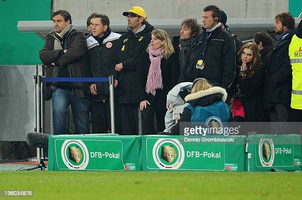 Head coach Juergen Klopp of Dortmund watches the game after having to leave the pitch during the DFB Cup round of sixteen match between Fortuna...