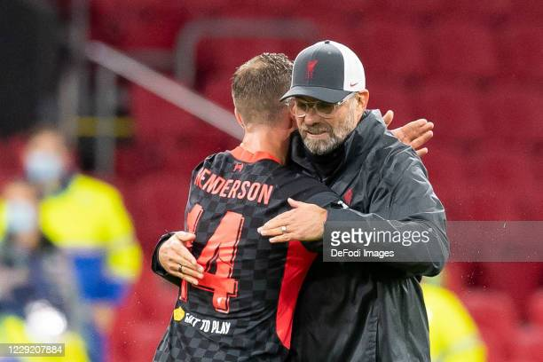 head coach Juergen Klopp of FC Liverpool and Jordan Henderson of FC Liverpool celebrate after winning the UEFA Champions League Group D stage match...