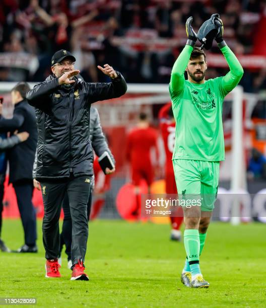 head coach Juergen Klopp of Liverpool and goalkeeper Alisson Becker of Liverpool gesture after the UEFA Champions League Round of 16 Second Leg match...
