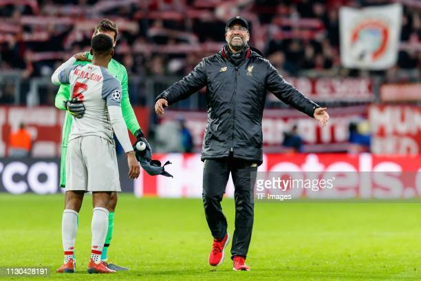 head coach Juergen Klopp of Liverpool and goalkeeper Alisson Becker of Liverpool celebrate after the UEFA Champions League Round of 16 Second Leg...