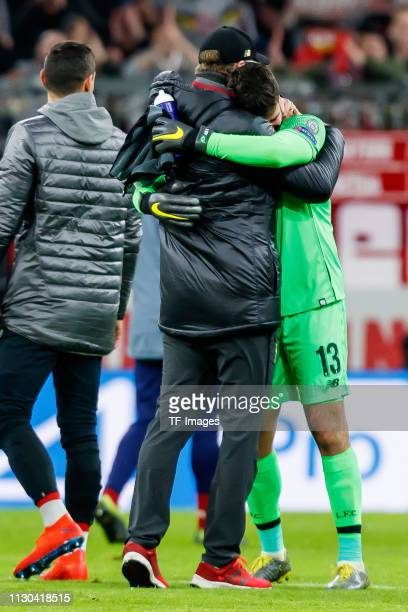 head coach Juergen Klopp of Liverpool celebrates with goalkeeper Alisson Becker of Liverpool after the UEFA Champions League Round of 16 Second Leg...