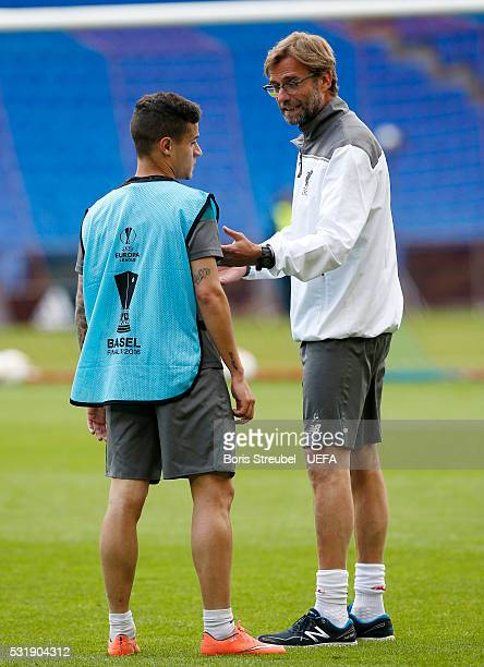 Head coach Juergen Klopp of Liverpool gives advices to Philippe Coutinho during the Liverpool FC training session ahead of the UEFA Europa League...
