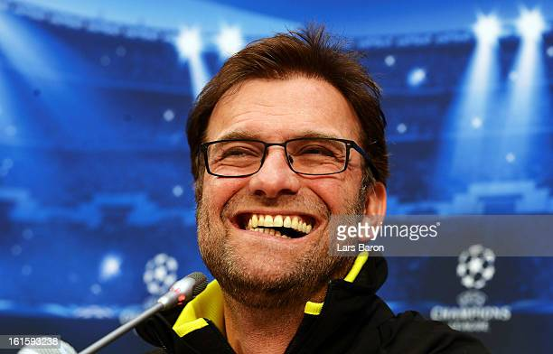 Head coach Juergen Klopp smiles during a Borussia Dortmund press conference ahead of their UEFA Champions League round of 16 match against Shakhtar...