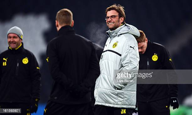 Head coach Juergen Klopp smiles during a Borussia Dortmund training session ahead of their UEFA Champions League round of 16 match against Shakhtar...