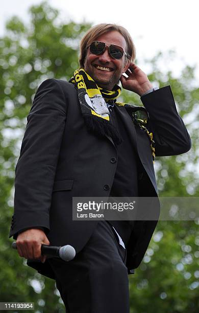 Head coach Juergen Klopp smiles on the stage during the Borussia Dortmund Bundesliga winners parade at Westfalenhalle on May 15 2011 in Dortmund...