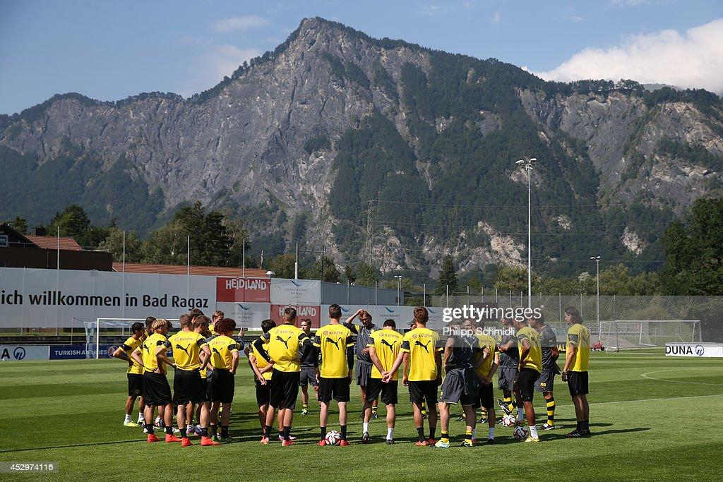 Head coach Juergen Klopp speaks to his team prior to a training session in the Borussia Dortmund training camp on July 31, 2014 in Bad Ragaz, Switzerland.