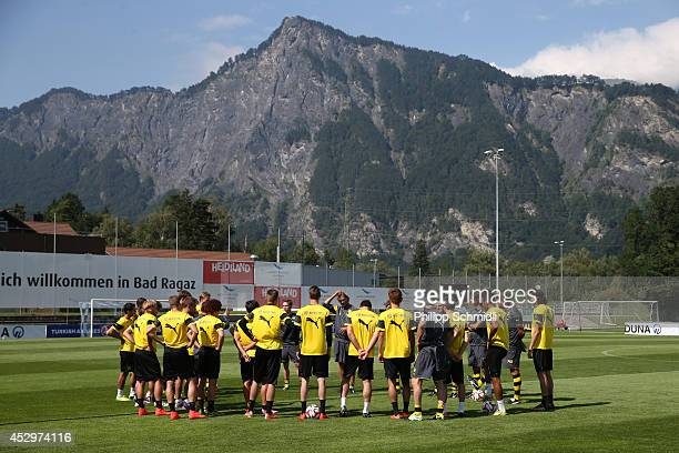 Head coach Juergen Klopp speaks to his team prior to a training session in the Borussia Dortmund training camp on July 31, 2014 in Bad Ragaz,...