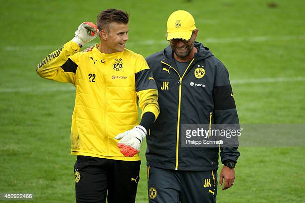Head coach Juergen Klopp speaks with Mitchell Langerak during the Borussia Dortmund training camp on July 30, 2014 in Bad Ragaz, Switzerland.