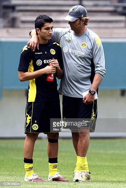 Head coach Juergen Klopp talks to Nuri Sahin during the Borussia Dortmund first training session for the upcoming season 2010/2011 at the Signal...