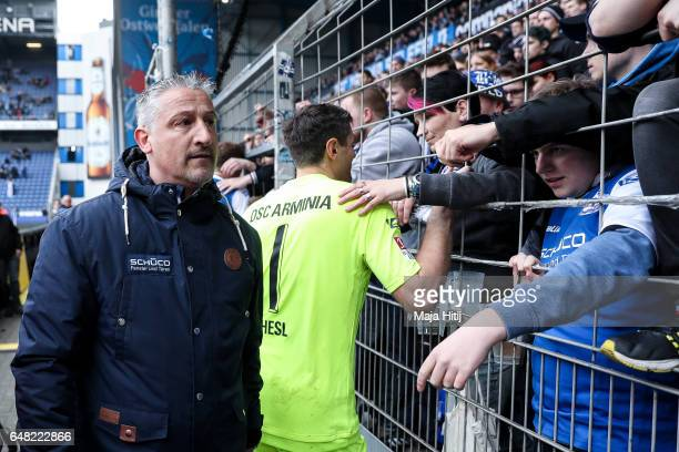 Head coach Juergen Kramny of Bielefeld and Wolfgang Hesl talk to the fans after the Second Bundesliga match between DSC Arminia Bielefeld and FC...