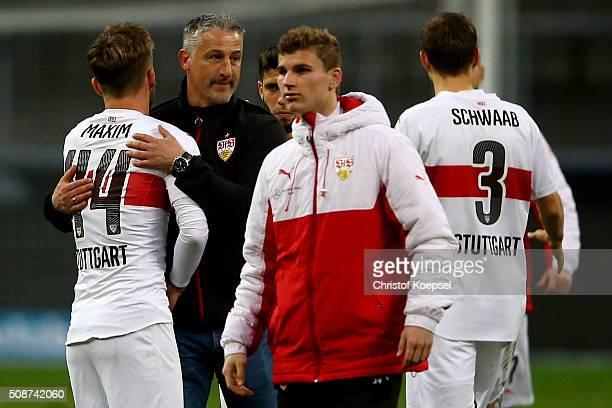 Head coach Juergen Kramny of Stuttgart embraces Alexandru Maxim after winning the Bundesliga match between Eintracht Frankfurt and VfB Stuttgart at...