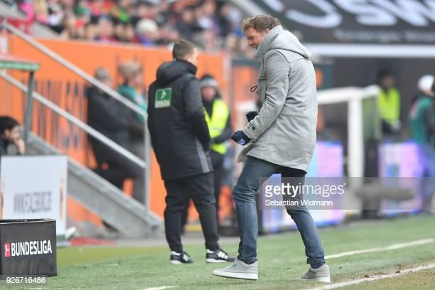 Head coach Julian Nagelsmann of Hoffenheim celebrates his teams first goal during the Bundesliga match between FC Augsburg and TSG 1899 Hoffenheim at...