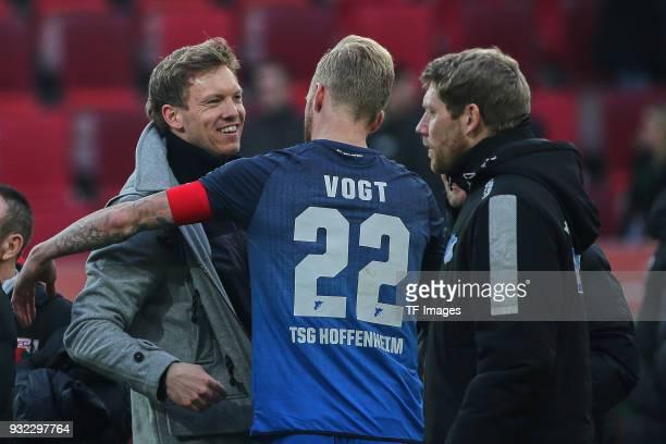 Head coach Julian Nagelsmann of Hoffenheim hugs Kevin Vogt of Hoffenheim after the Bundesliga match between FC Augsburg and TSG 1899 Hoffenheim at...