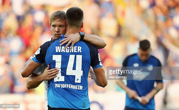 Head coach Julian Nagelsmann of Hoffenheim hugs Sandro Wagner after the Bundesliga match between 1 FSV Mainz 05 and TSG 1899 Hoffenheim at Opel Arena...