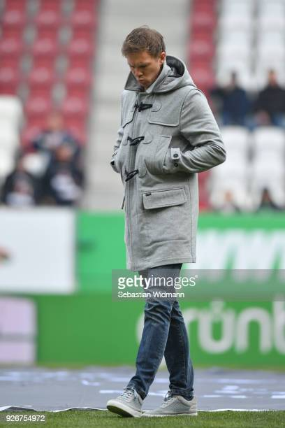 Head coach Julian Nagelsmann of Hoffenheim looks down prior to the Bundesliga match between FC Augsburg and TSG 1899 Hoffenheim at WWKArena on March...