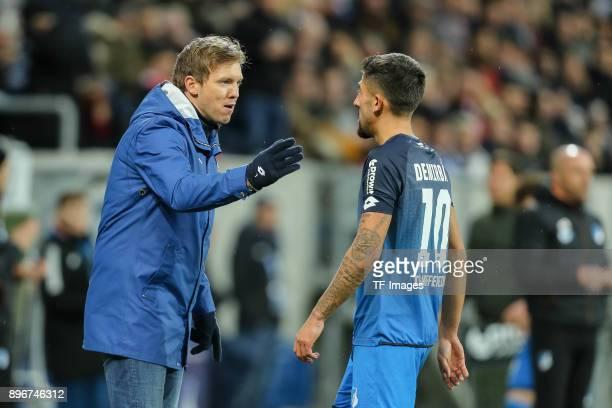 Head coach Julian Nagelsmann of Hoffenheim speaks with Kerem Demirbay of Hoffenheim during the Bundesliga match between TSG 1899 Hoffenheim and VfB...