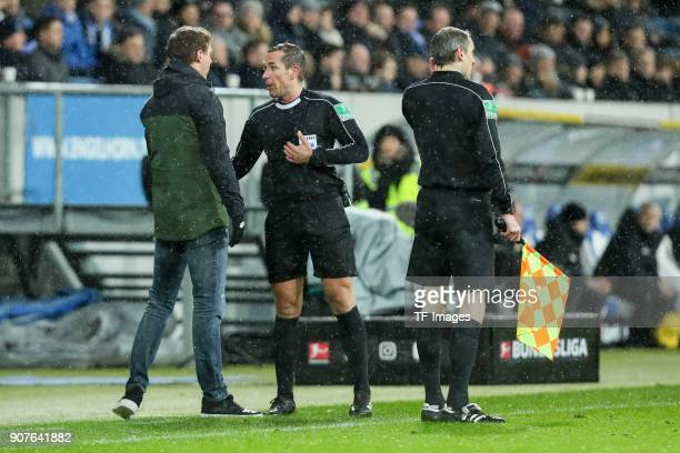 Head coach Julian Nagelsmann of Hoffenheim speaks with Referee Felix Zwayer during the Bundesliga match between TSG 1899 Hoffenheim and Bayer 04...