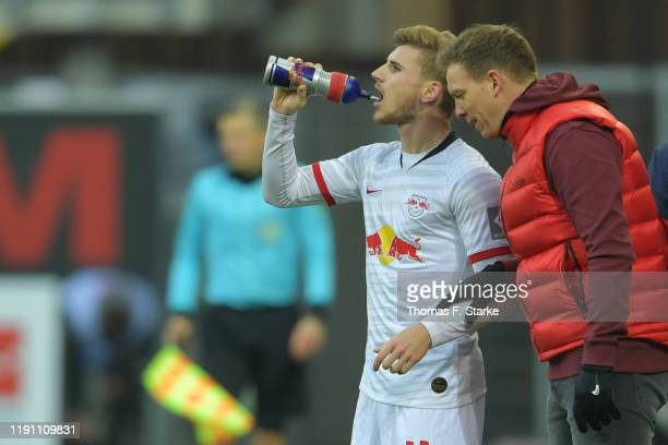 Head coach Julian Nagelsmann of Leipzig gives advice to his player Timo Werner during the Bundesliga match between SC Paderborn 07 and RB Leipzig at...