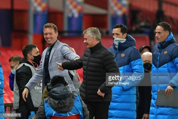 head coach Julian Nagelsmann of RB Leipzig and head coach Ole Gunnar Solskjær of Manchester United gestures during the UEFA Champions League Group H...