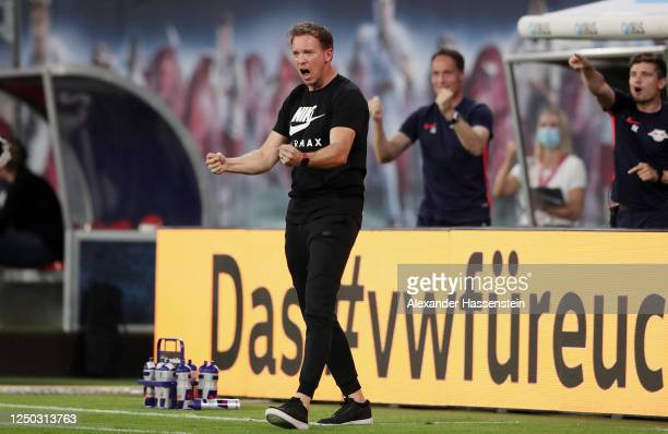 Head coach Julian Nagelsmann of RB Leipzig celebrates after his team's first goal during the Bundesliga match between RB Leipzig and Fortuna...