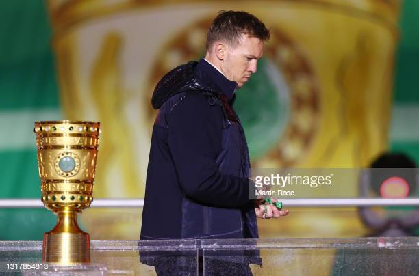 Head coach Julian Nagelsmann of RB Leipzig looks dejected as he walks past the trophy after the DFB Cup final match between RB Leipzig and Borussia...