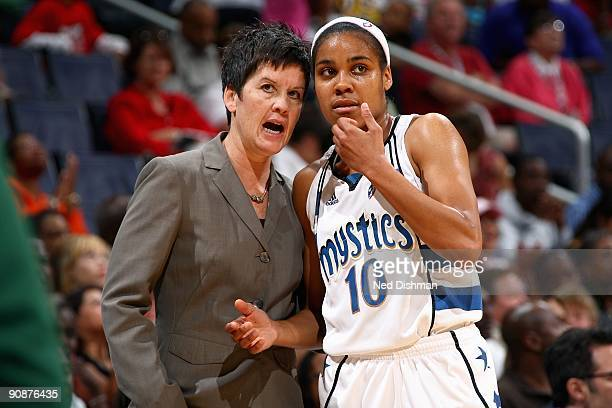 Head coach Julie Plank talks to Lindsey Harding of the Washington Mystics during the WNBA game against the Seattle Storm on September 3 2009 at the...
