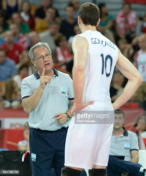 Head coach Julio Velasco of Argentina gives the instructions to Jose Luis Gonzalez during the FIVB World Championships match between Argentina and...