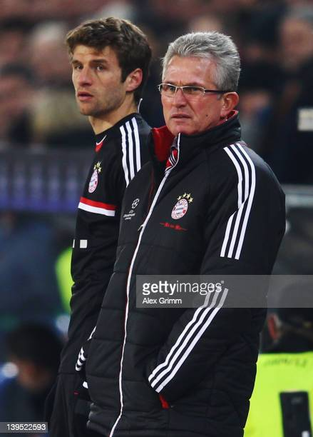 Head coach Jupp Heynckes and Thomas Mueller of Muenchen look on during the UEFA Champions League Round of 16 first leg match between FC Basel 1893...
