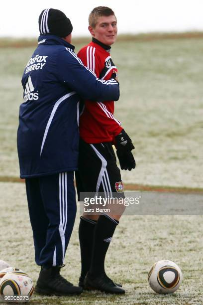 Head coach Jupp Heynckes hugs Toni Kroos during a Bayer 04 Leverkusen training session on January 27 2010 in Leverkusen Germany