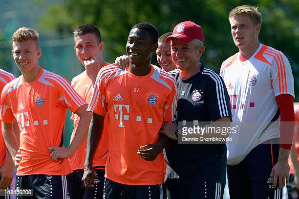 Head coach Jupp Heynckes jokes with David Alaba during day three of the Bayern Muenchen pre-season training camp at Arco Stadium on July 17, 2012 in...