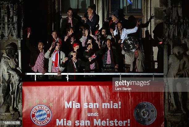 Head coach Jupp Heynckes of Bayern Muenchen and his team celebrate with the trophy the German championship title on the town hall balcony at...