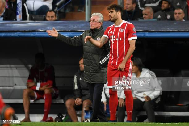 Head coach Jupp Heynckes of Bayern Muenchen gives instruction to Javi Martinez during the UEFA Champions League Semi Final Second Leg match between...