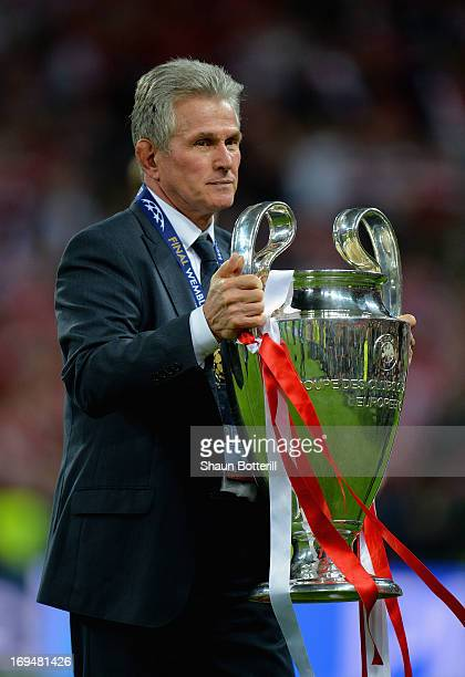 Head Coach Jupp Heynckes of Bayern Muenchen holds the trophy after winning the UEFA Champions League final match against Borussia Dortmund at Wembley...