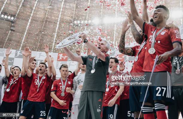 Head coach Jupp Heynckes of FC Bayern Muenchen lifts the trophy Meisterschale after the Bundesliga match between FC Bayern Muenchen and VfB Stuttgart...