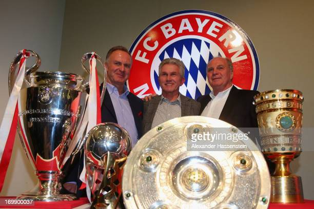 Head coach Jupp Heynckes of FC Bayern Muenchen poses alongside Club President Uli Hoeness FC Bayern Muenchen CEO KarlHeinz Rummenigge as they place...