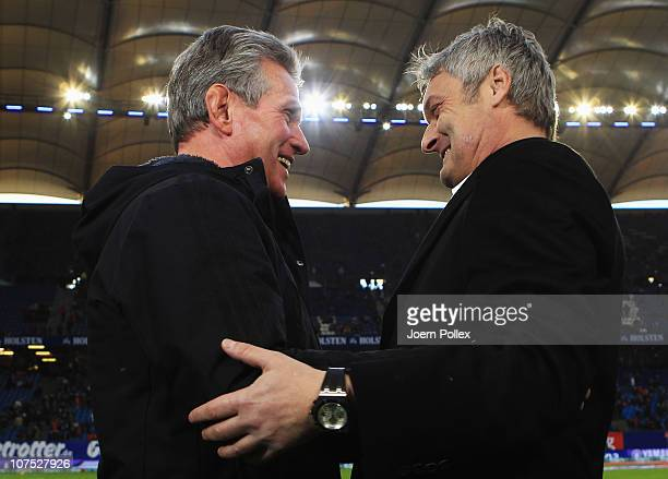 Head coach Jupp Heynckes of Leverkusen and head coach Armin Veh of Hamburg chat prior to the Bundesliga match between Hamburger SV and Bayer...