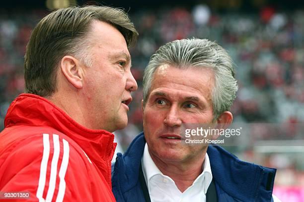 Head coach Jupp Heynckes of Leverkusen talks to head coach Louis van Gaal of Bayern before the Bundesliga match between Bayern Muenchen and Bayer...
