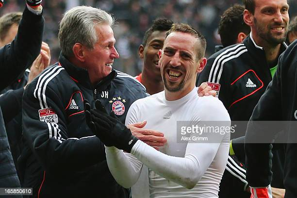 Head coach Jupp Heynckes of Muenchen celebrates winning the Bundesliga with Franck Ribery after the match between Eintracht Frankfurt and FC Bayern...