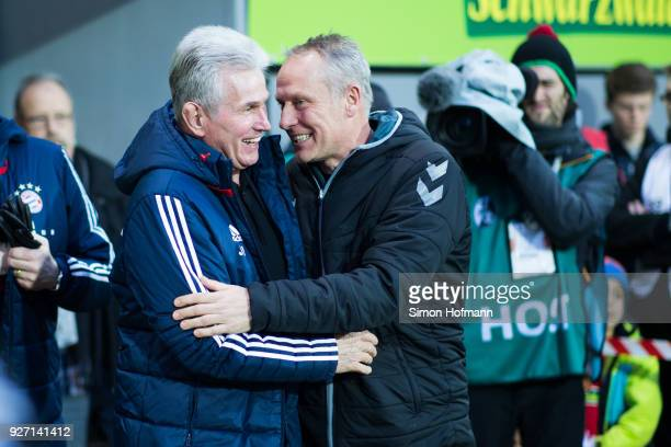 Head coach Jupp Heynckes of Muenchen chats with Head coach Christian Streich of Freiburg during the Bundesliga match between SportClub Freiburg and...