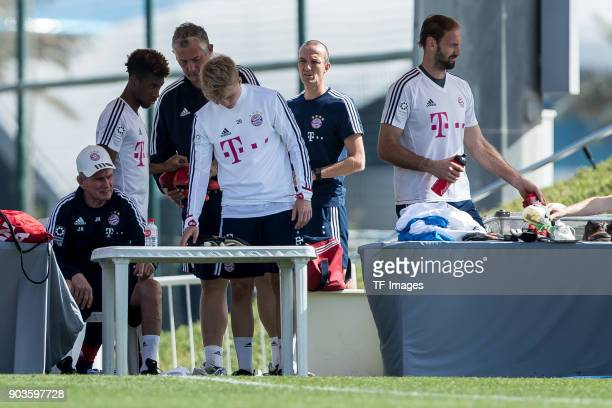 Head coach Jupp Heynckes of Muenchen Felix Goetze of Muenchen and Goalkeeper Tom Starke of Muenchen look on during the FC Bayern Muenchen training...