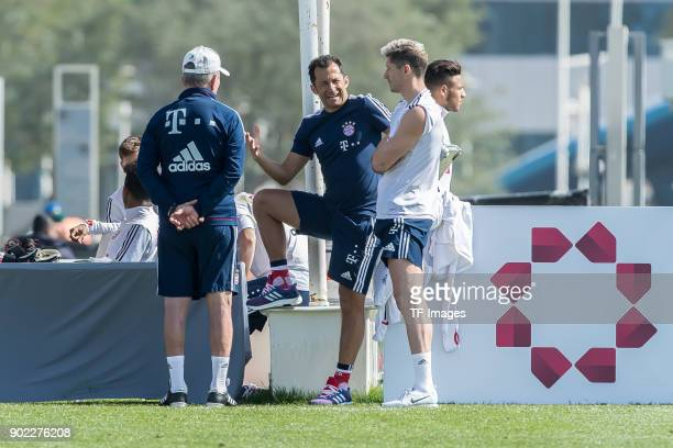 Head coach Jupp Heynckes of Muenchen speaks with Sporting director Hasan Salihamidzic of Muenchen and Robert Lewandowski of Muenchen during the FC...