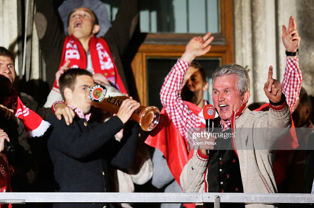 Head coach Jupp Heynckes (R), Philipp Lahm and team mates of Bayern Muenchen celebrate the German championship title on the town hall balcony at Marienplatz on May 11, 2013 in Munich, Germany.