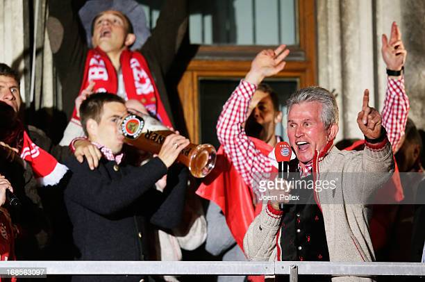 Head coach Jupp Heynckes , Philipp Lahm and team mates of Bayern Muenchen celebrate the German championship title on the town hall balcony at...