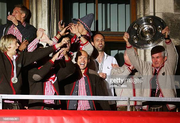 Head coach Jupp Heynckes Philipp Lahm and team mates of Bayern Muenchen celebrate the German championship title on the town hall balcony at...